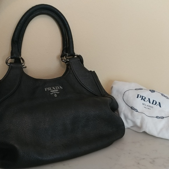 ce6dc51a0f2bc9 Prada hobo leather bag. M_5ba8346a34a4ef04063f810f